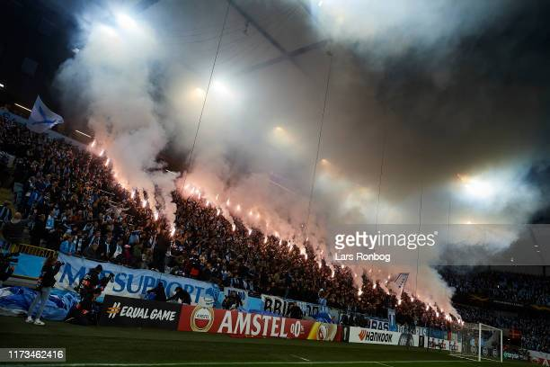 The Malmo FF fans with pyrotechnics prior to the UEFA Europa League match between Malmo FF and FC Copenhagen at Stadion Malmo on October 3 2019 in...