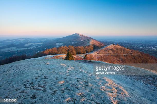 the malvern hills on a frosty winter morning. herfordshire and worcestershire. england. uk. - worcestershire stock pictures, royalty-free photos & images