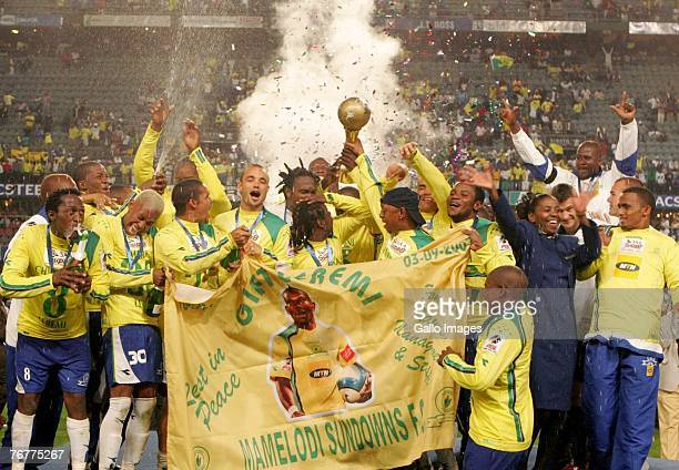 The Mamelodi Sundowns players pose with the Trophy after winning the final during the SAA Supa 8 Final match between the Mamelodi Sundowns and the...