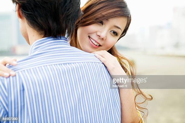 The man and woman who embraces each other