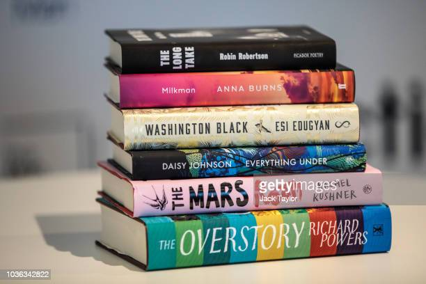 The Man Booker Prize shortlist of six books are arranged for a photograph during a press conference at Riverbank House on September 20 2018 in London...