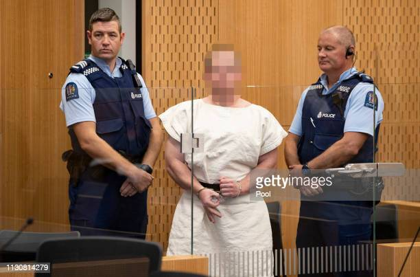 The man charged in relation to the Christchurch massacre Brenton Tarrant gestures as he is led into the dock for his appearance for murder in the...