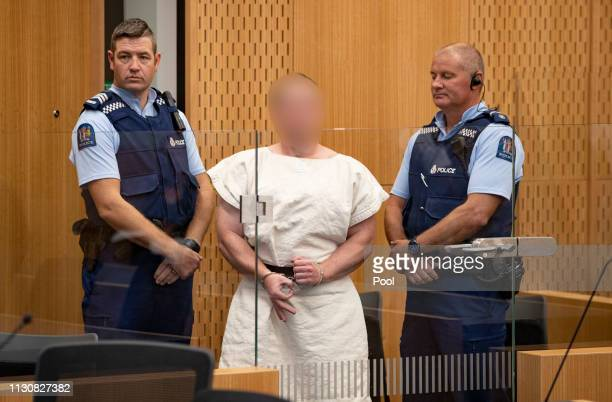 The man charged in relation to the Christchurch massacre Brenton Tarrant gestures in the dock for his appearance for murder in the Christchurch...