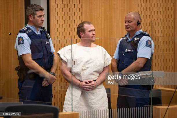 The man charged in relation to the Christchurch massacre, Brenton Tarrant, gestures in the dock for his appearance for murder in the Christchurch...