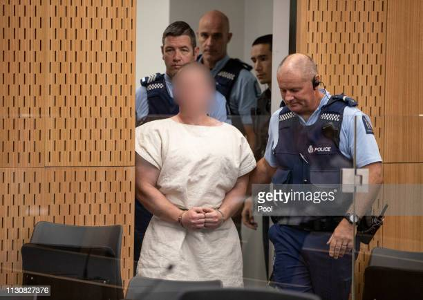 The man charged in relation to the Christchurch massacre Brenton Tarrant is led into the dock for his appearance for murder in the Christchurch...