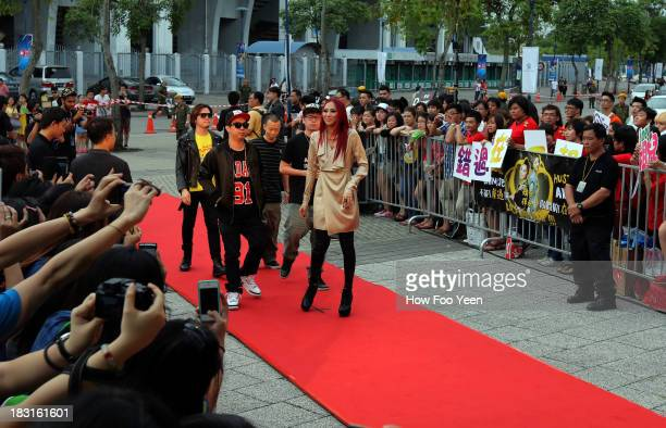The Man Hand Rap Group arrives at the red Carpet during the 13th Global Chinese Music Awards at Putra Stadium on October 5 2013 in Kuala Lumpur...