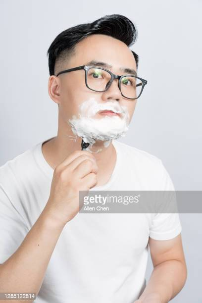 the man in a white t-shirt is shaving - shaved stock pictures, royalty-free photos & images