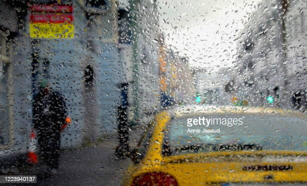 the man in the rain - weather stock pictures, royalty-free photos & images