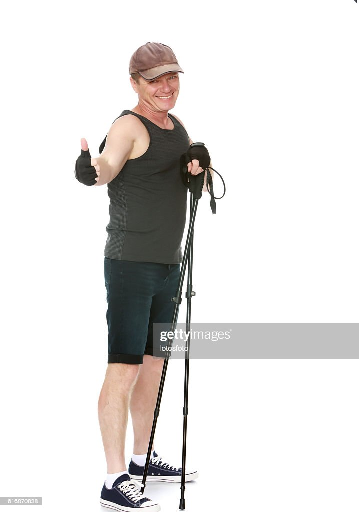 The man is engaged in Nordic walking : Stock Photo