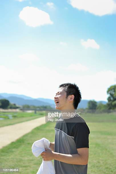 The man laughing with having a towel