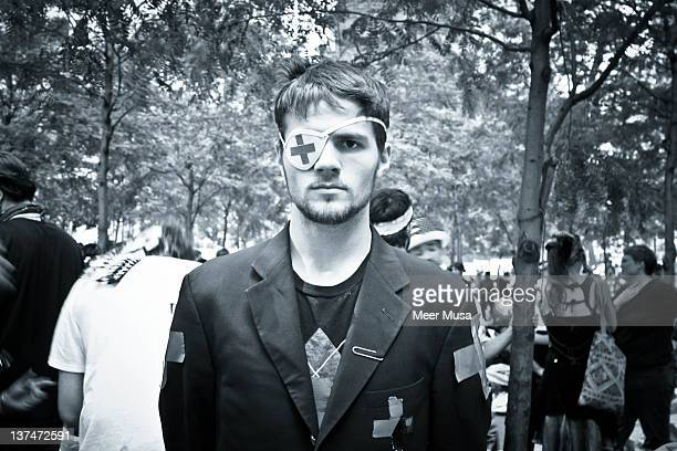 The man lives in Brooklyn. He was volunteering as a medic at Occupy Wall Street. Zuccotti Park, New York City 2011