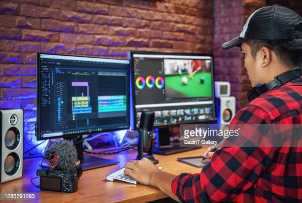the man makes video editing. video production. - multimedia stock pictures, royalty-free photos & images