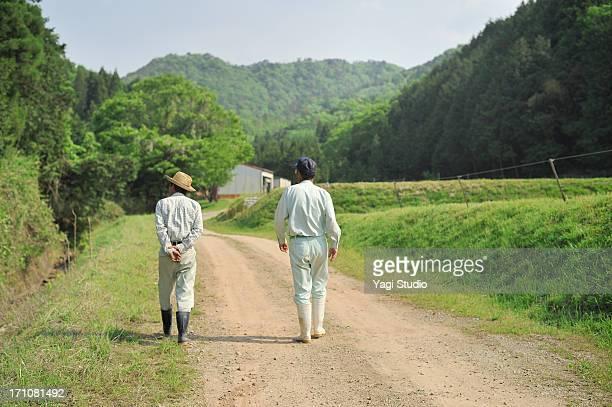 The man of two farmers walking,Japan