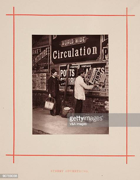 The man on the right is pasting a poster advertising a portrait model at Madame Tussaud�s Waxworks of �William Fish the Blackburn Murderer�...