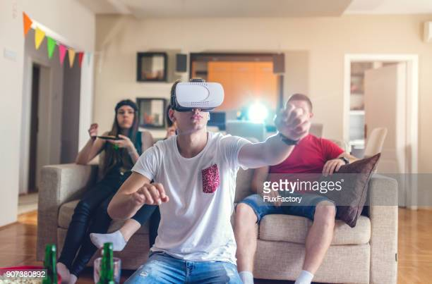 The man playing the video game with VR