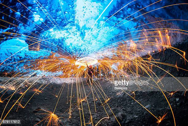 The man playing with steel wool on the ice cave.