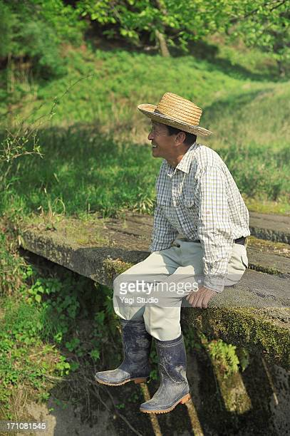 The man who is relaxed on a wooden bridge