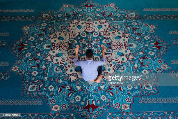 the man who makes prayer in the mosque - diyarbakir stock pictures, royalty-free photos & images