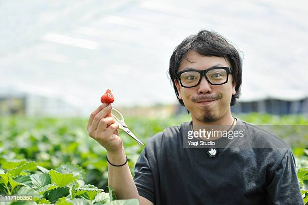 The man who picks a strawberry