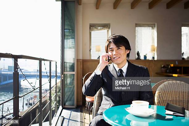 The man who talks on the telephone in a cafe