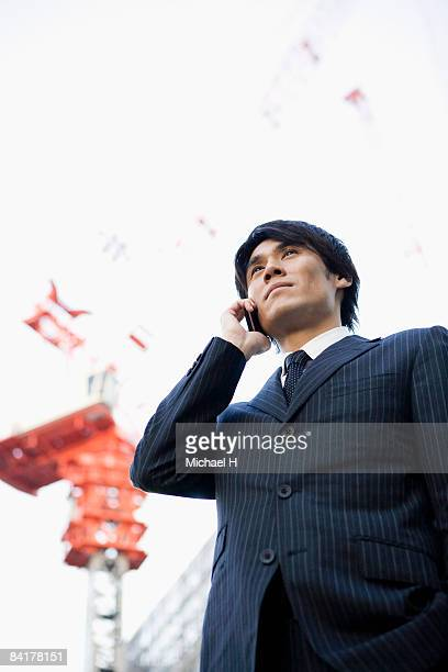 The man who talks on the telephone on the site