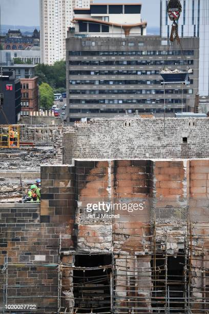 Workmen take down the roof on the O2 ABC music venue next to Glasgow School of Art's Mackintosh building where work to take down the damaged masonry...