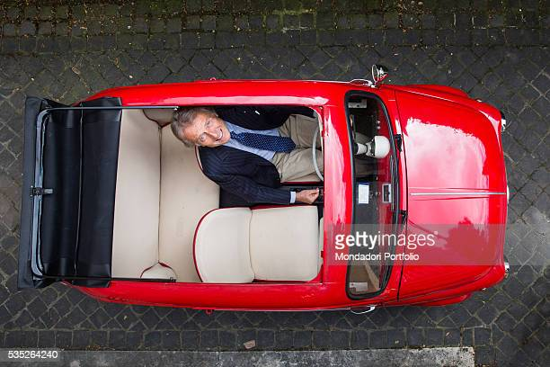 The manager Luca Cordero di Montezemolo in a vintage Fiat 500 repainted in original Ferrari Red by the body shop mechanic from Abruzzo Vincenzo...