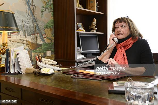 The manager of the Cabinet Duluc detective agency, Martine Baret, speaks with a customer on the phone, in her office in Paris, on April 16, 2014....