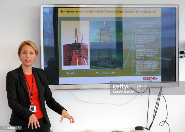 The manager of the Danish energy company DONG Energy Trine Borum Bojsen presents a graphic on the new tripod system used in the construction of the...