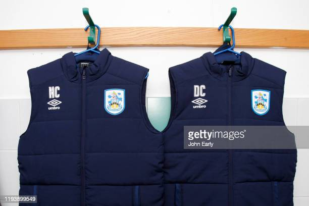 The Managers Danny and Nicky Cowley's jackets hang in the Huddersfield Town dressing room before the Sky Bet Championship match between Wigan...