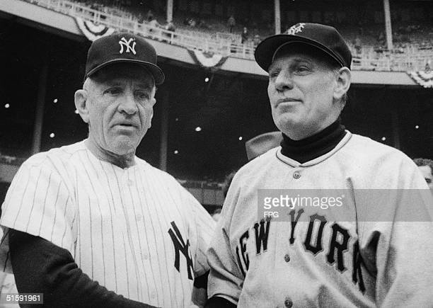 The managers of the two opposing teams in the World Series Casey Stengel of the New York Yankees and Leo Durocher of the New York Giants pose...