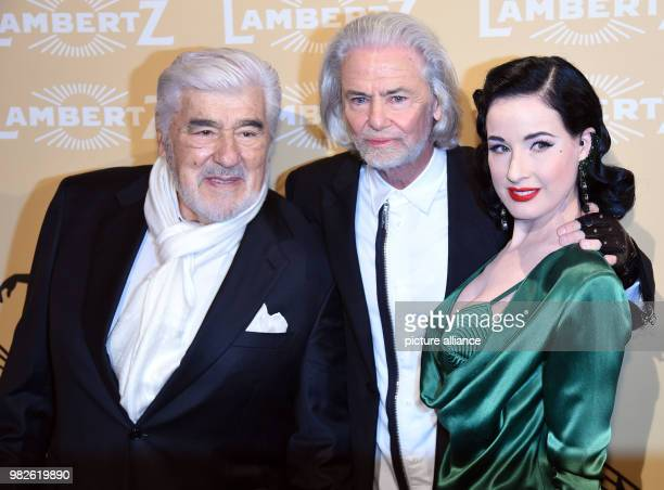 The managing director of Lambertz Hermann Buehlbecker greeting actor Mario Adorf and dancer Dita von Teese to the 'Lambertz Monday Night' in Cologne...