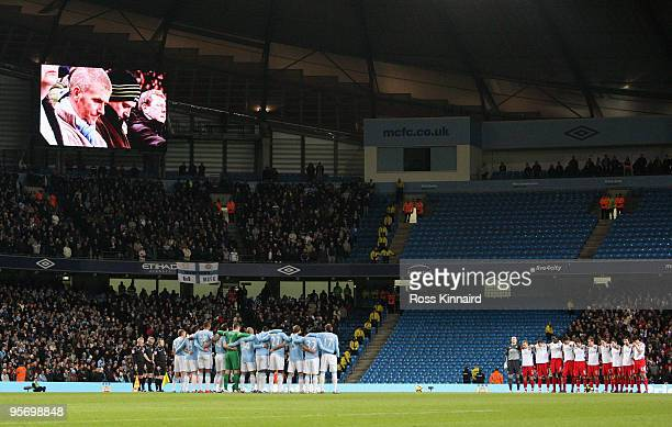 The Manchester City and Blackburn Rovers players observe a minutes silence for the victims of the shooting of the Togolese bus at the African Nations...