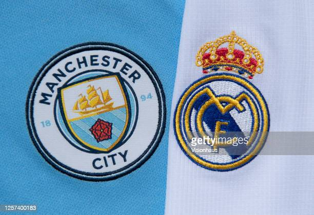 The Manchester City and Real Madrid club crests on the first team home shirts on July 19, 2020 in Manchester, United Kingdom.