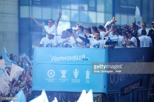The Manchester City bus drives through the crowd during the Manchester City trophy parade in Manchester on May 20 2019 in Manchester England