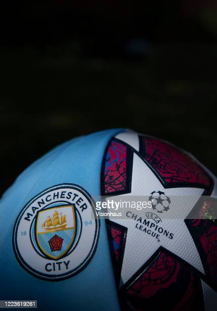 The Manchester City club crest on the first team home shirt displayed with a UEFA Champions League match ball on May 5 2020 in Manchester England