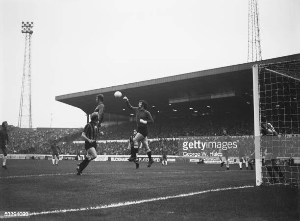 The Manchester City keeper punches the ball clear during a match against Chelsea at Stamford Bridge London 21st August 1971