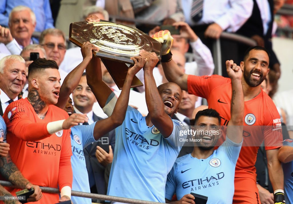 The Manchester City players celebrate as Vincent Kompany and Fernandinho lift the Community Shield trophy after the FA Community Shield match between Manchester City and Chelsea at Wembley Stadium on August 5, 2018 in London, England.