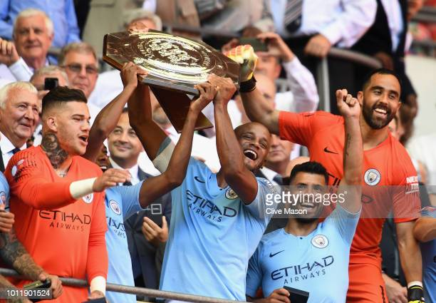 The Manchester City players celebrate as Vincent Kompany and Fernandinho lift the Community Shield trophy after the FA Community Shield match between...