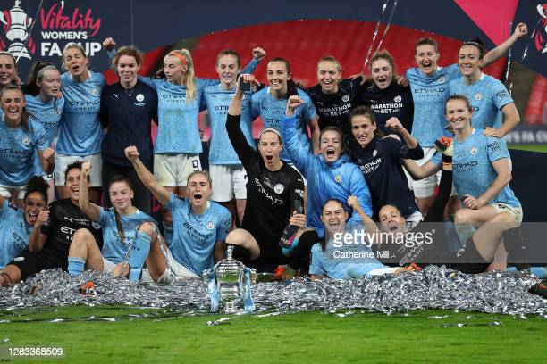 The Manchester City players celebrate with the Vitality Women's FA Cup Trophy following their team's victory in the Vitality Women's FA Cup Final...