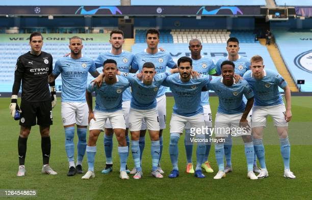 The Manchester City players pose for a team photo prior to the UEFA Champions League round of 16 second leg match between Manchester City and Real...