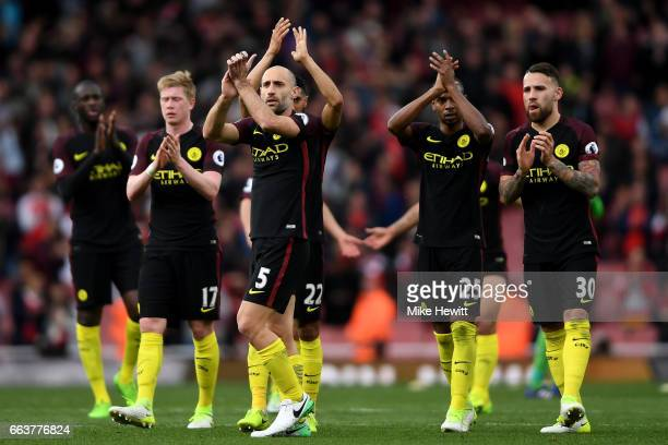 The Manchester City players shows appreciation to the fans after the Premier League match between Arsenal and Manchester City at Emirates Stadium on...