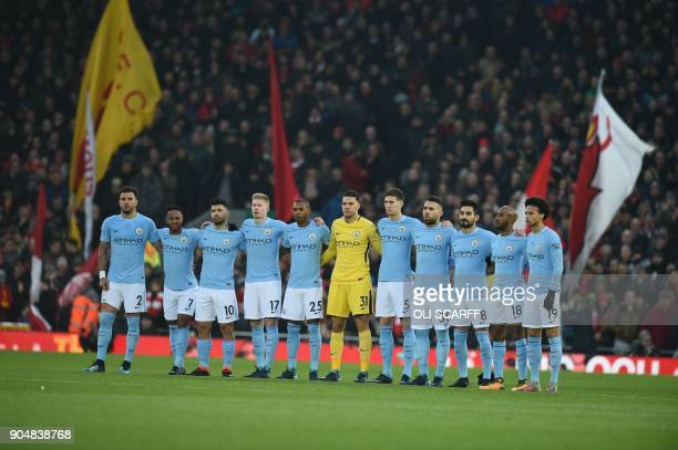 The Manchester City starting XI line up ahead of the English Premier League football match between Liverpool and Manchester City at Anfield in...