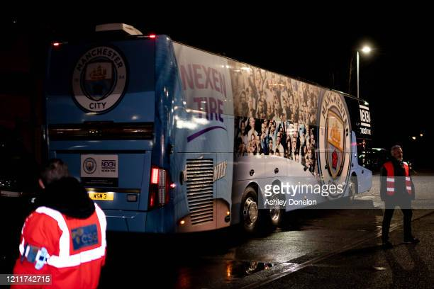 The Manchester City team bus leaves after the Premier League match between Manchester United and Manchester City at Old Trafford on March 08 2020 in...