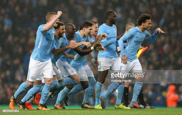 The Manchester City team celebrate a penalty scored during the Carabao Cup Fourth Round match between Manchester City and Wolverhampton Wanderers at...