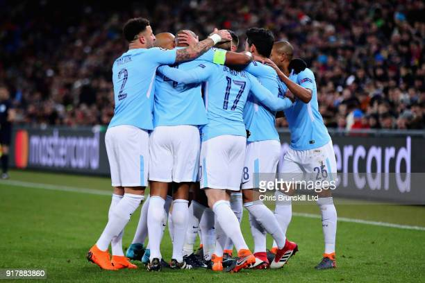 The Manchester City team celebrate after Ilkay Gundogan scored the opening goal during the UEFA Champions League Round of 16 First Leg match between...