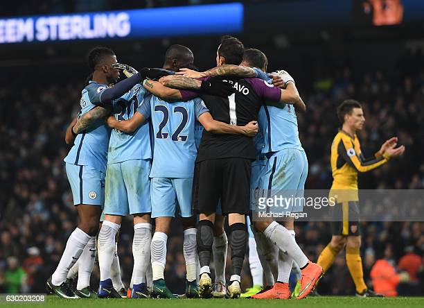 The Manchester City team celebrate after the final whistle during the Premier League match between Manchester City and Arsenal at the Etihad Stadium...