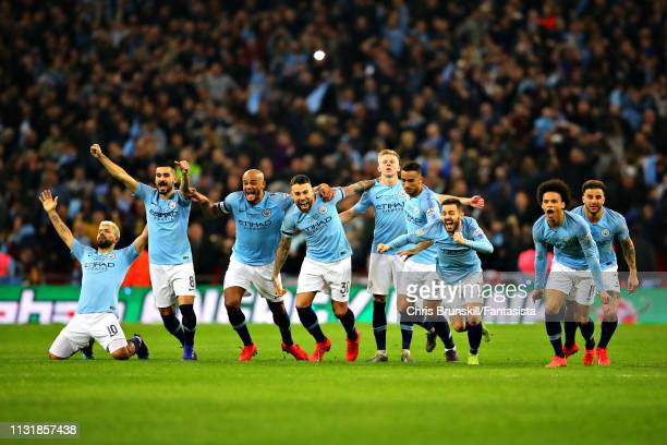 The Manchester City team celebrate after winning in the penalty shootout during the Carabao Cup Final between Chelsea and Manchester City at Wembley...