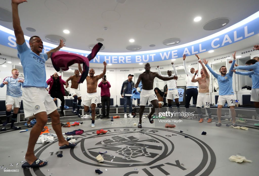 The Manchester City team celebrate in the dressing room after the Premier League match between Manchester City and Brighton and Hove Albion at Etihad Stadium on May 9, 2018 in Manchester, England.