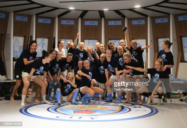 The Manchester City team celebrate in the dressing room with the Vitality Women's FA Cup Trophy following their team's victory in the Vitality...